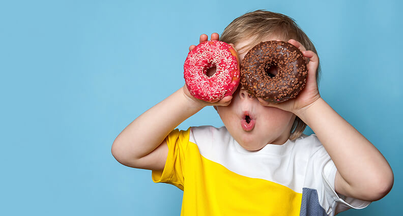 Kid with Doughnuts